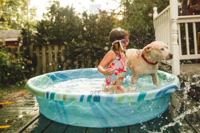 Dog in kiddie pool