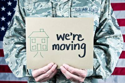 military-man-holding-were-moving-sign